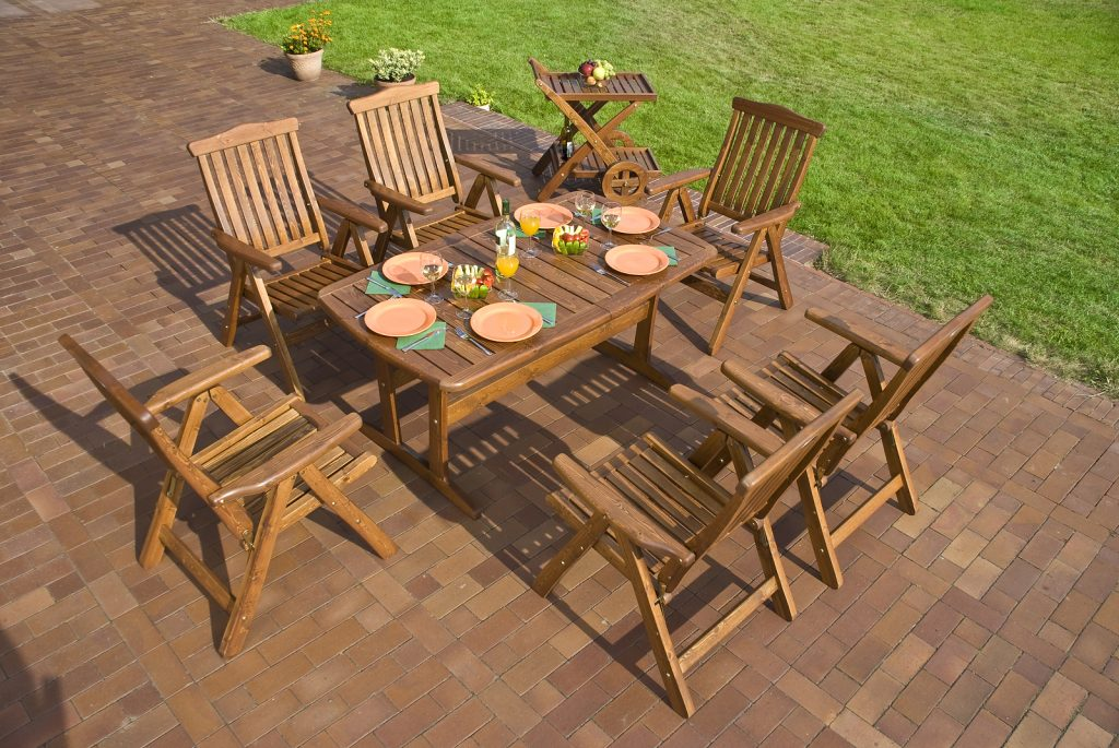 Garden teak furniture at the patio setting