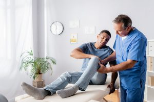 Chiropractor in Castle Hill treating an injured knee