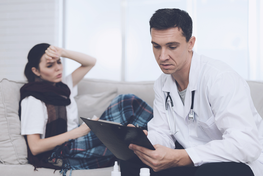 Gold Coast home doctor checking a female patient