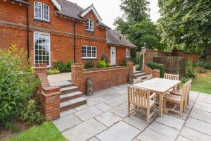 Large home with teak outdoor furniture